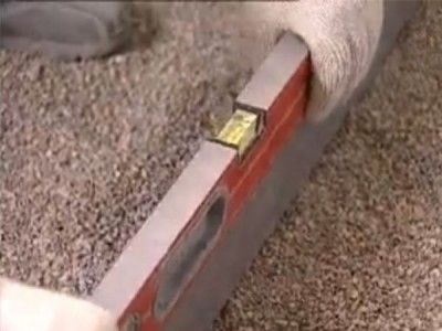 Подготовка основания под бетонный пол: проверка уровня пола