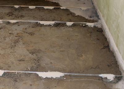Установка маяков для бетонного пола