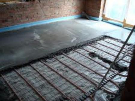 Электрический нагревательный кабель в бетонной стяжке